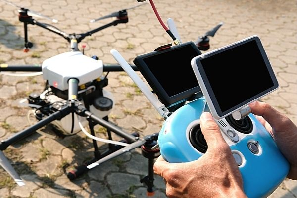man with drone and its remote control